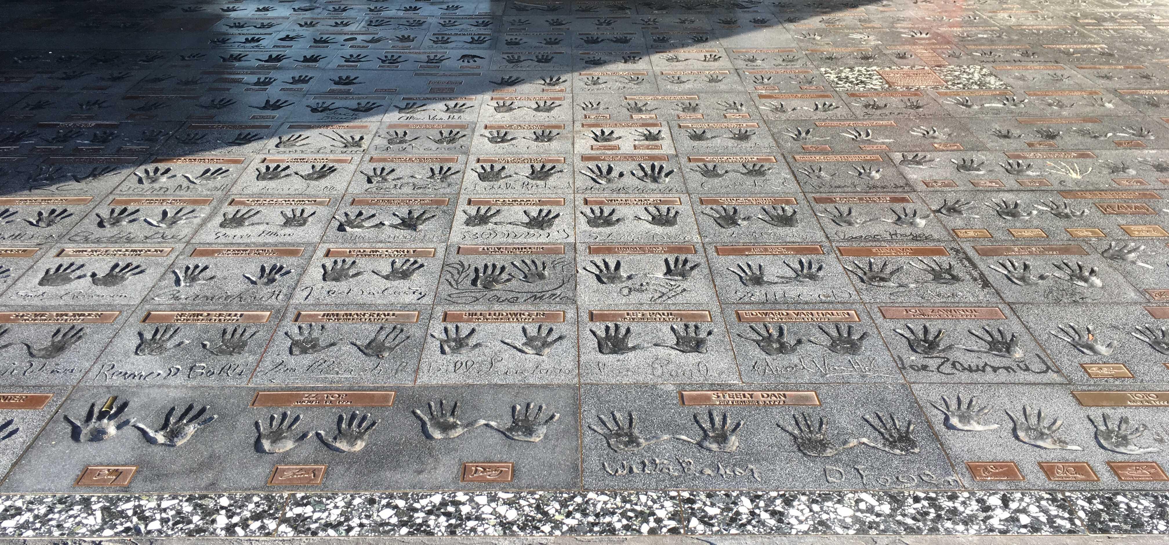 Sidewalk with hand prints