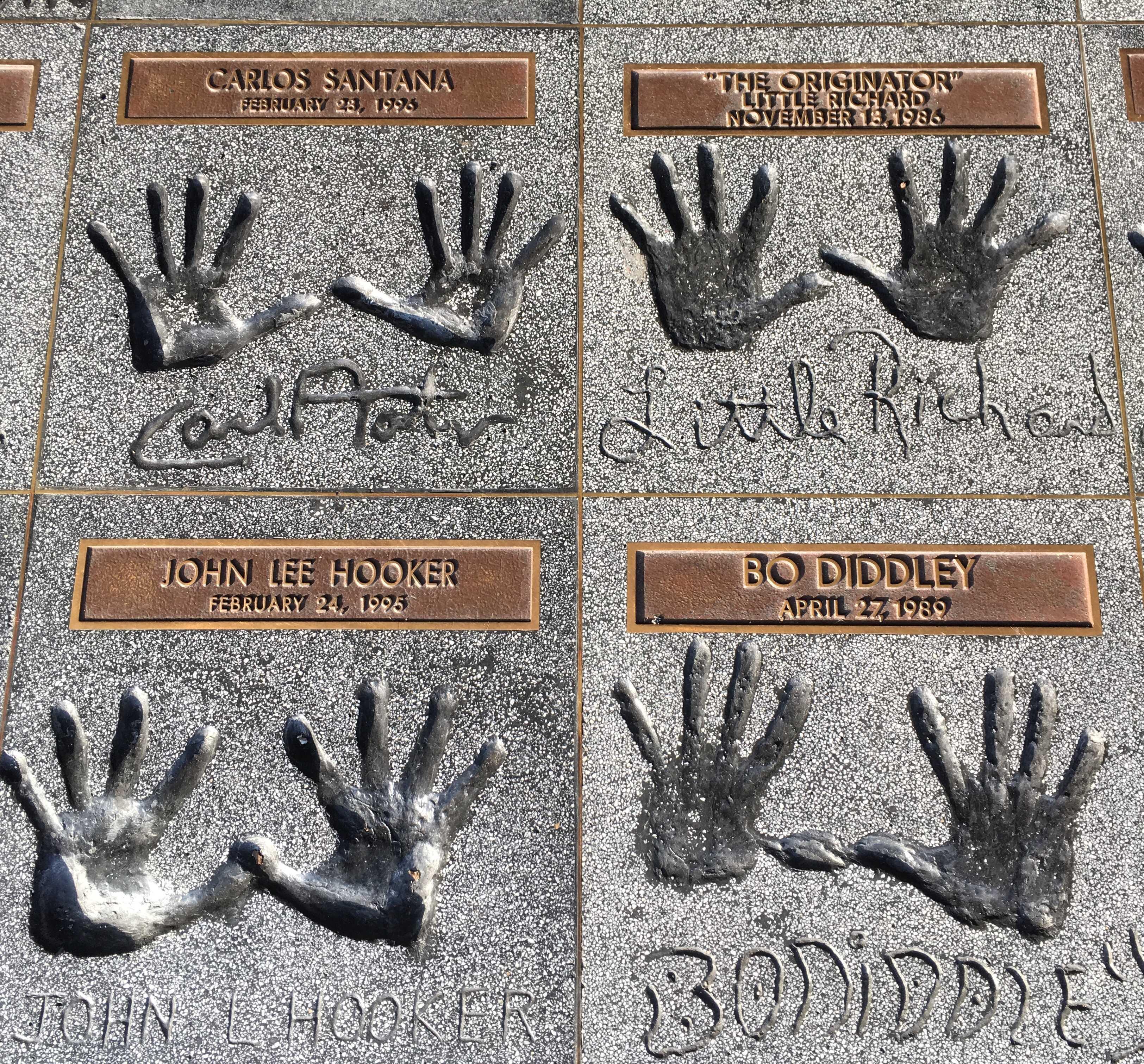 4 Hand Prints in Concrete