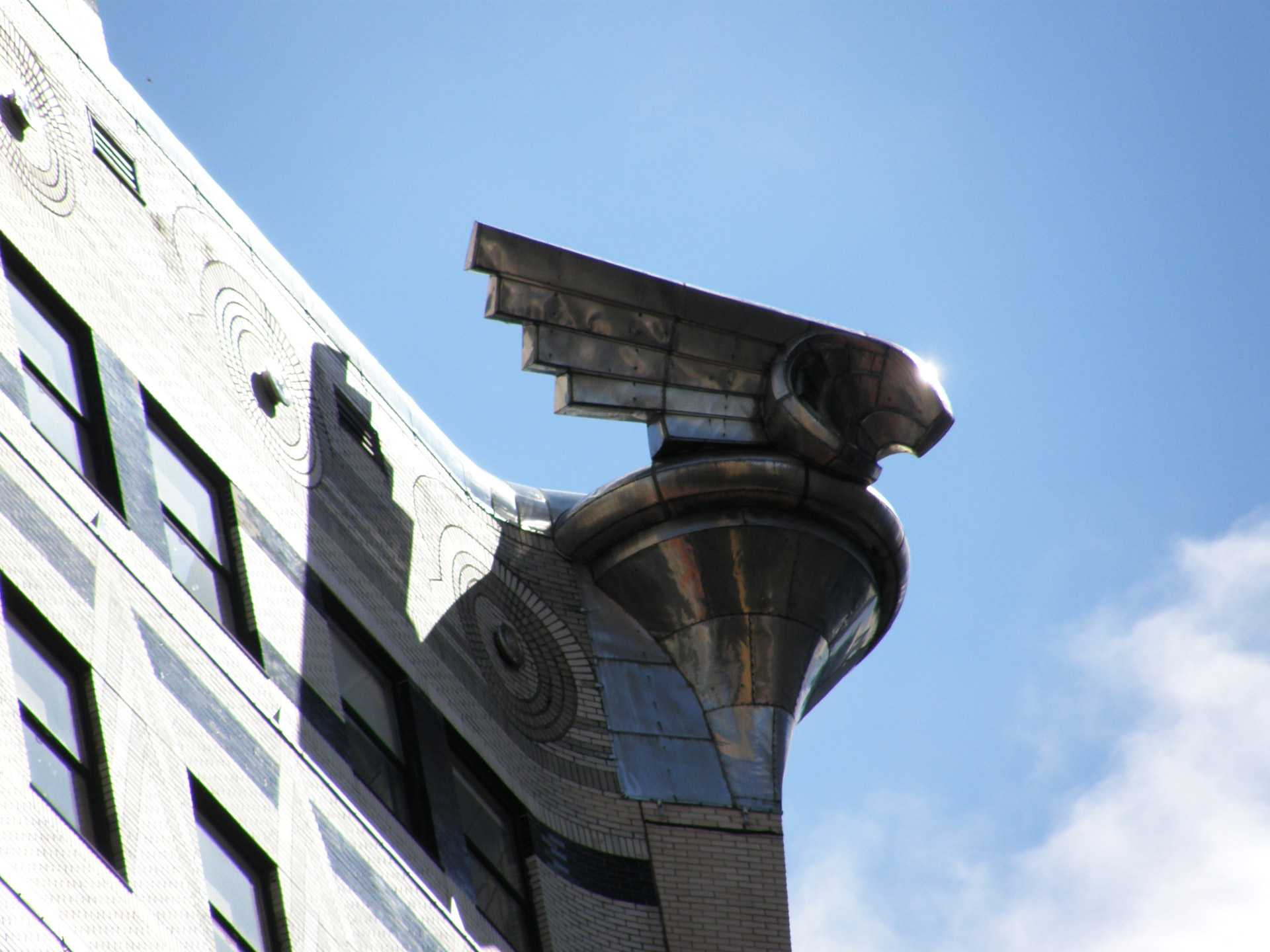 Eagle gargoyle on top of a building