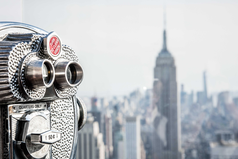 Binoculars overlooking building