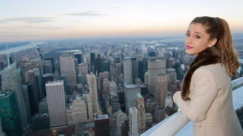 Woman standing over balcony