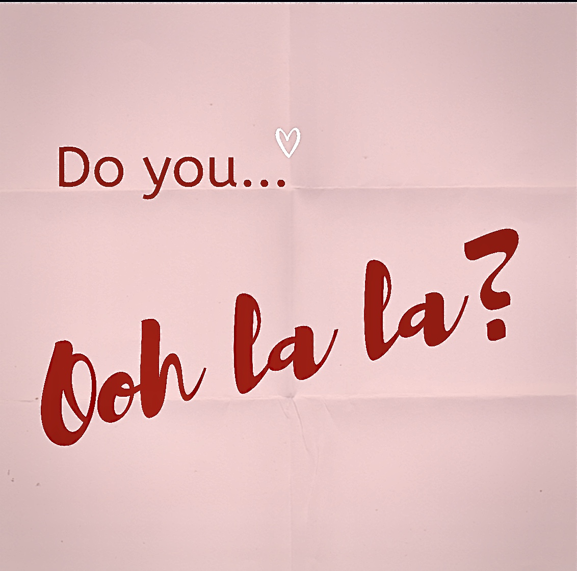 "Pink folded paper that says ""Do you Ooh la la?"""