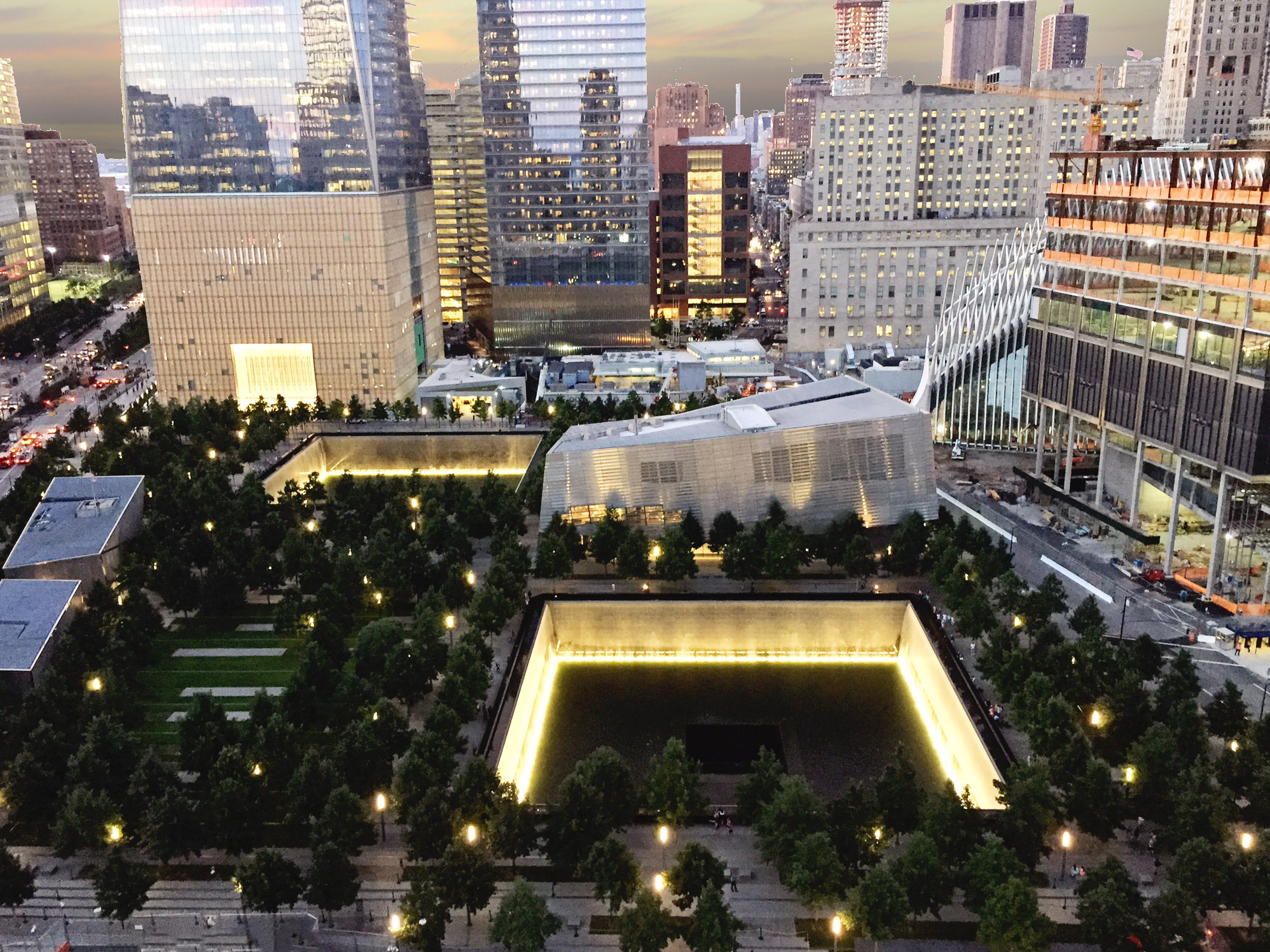 9/11 Memorial & Museum Lit Up with Gold Beams of Light